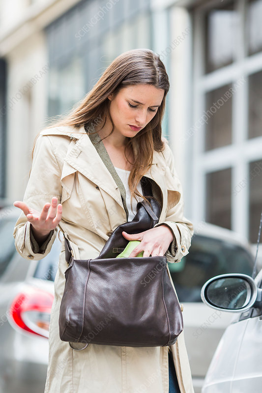 Woman looking into her handbag
