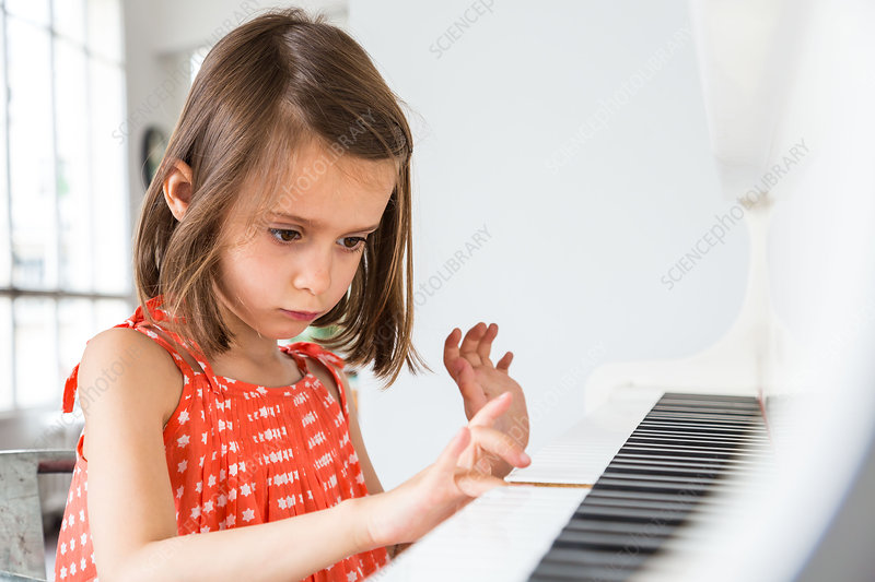 5-year-old girl playing the piano
