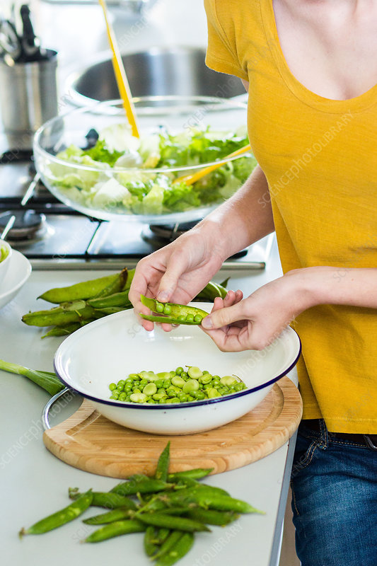 Woman preparing peas