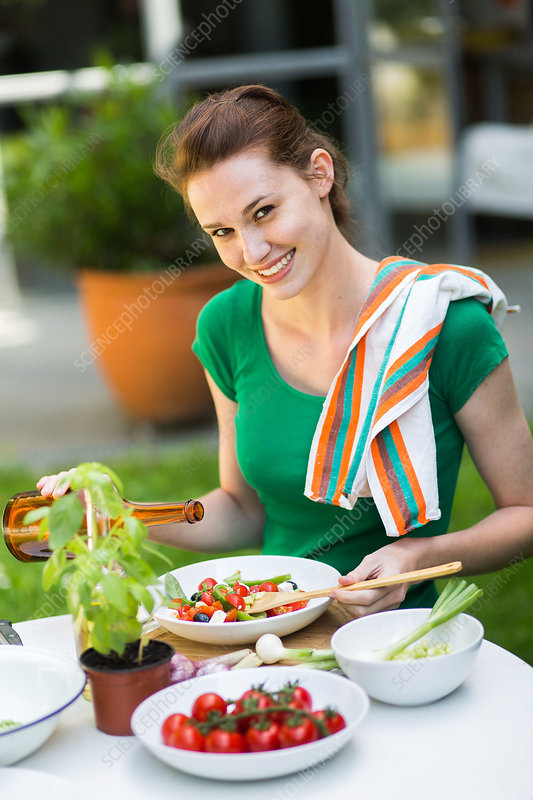 Woman eating a Mediterranean salad