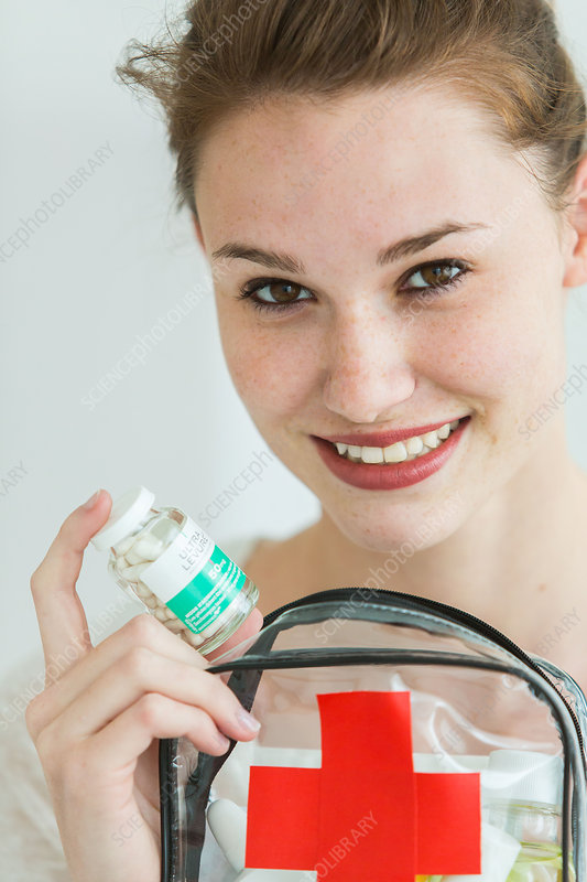 Woman holding a clear first aid kit