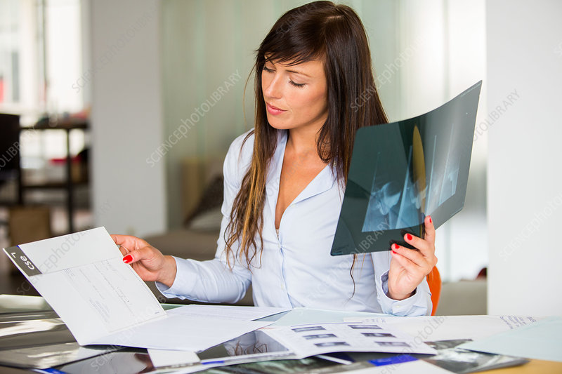 Woman sorting medical analysis results