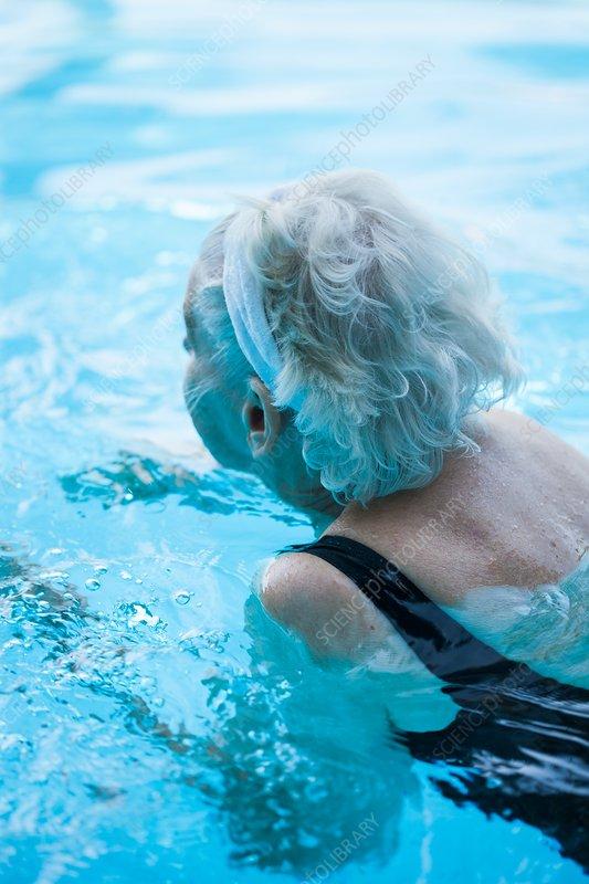 Elderly woman swimming