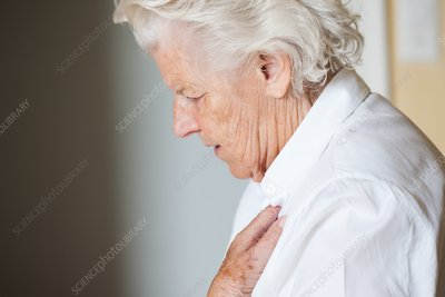 Elderly woman holding her chest