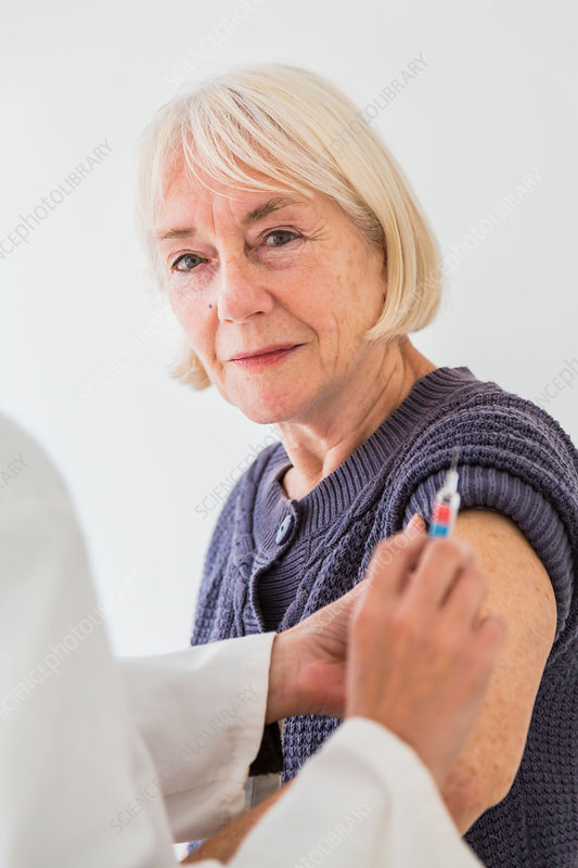 Woman receiving vaccination