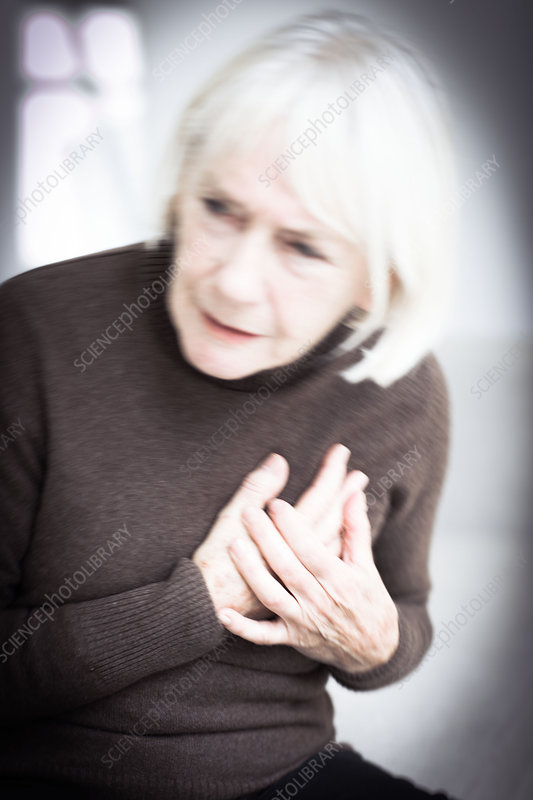 Senior woman clutching her painful chest