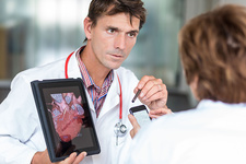 Doctors using a tablet PC and Iphone