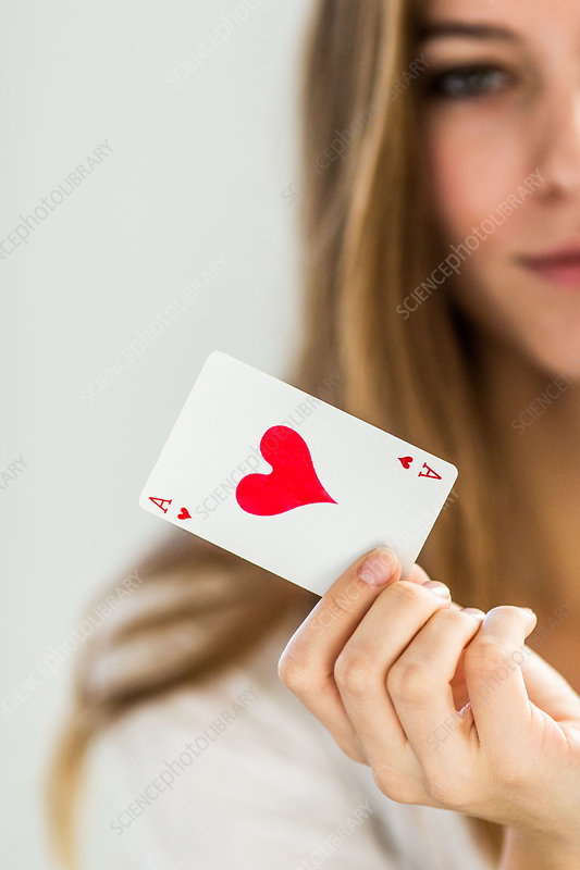 Female holding an ace of hearts