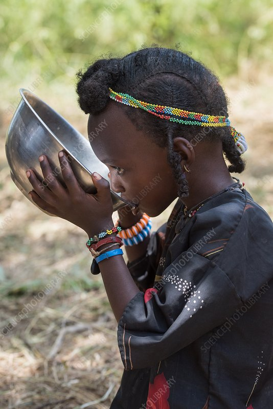 Wodaabe girl drinking water