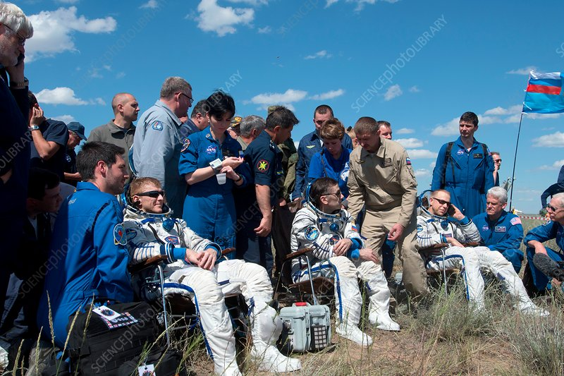 Soyuz TMA-19M astronauts after landing, June 2016