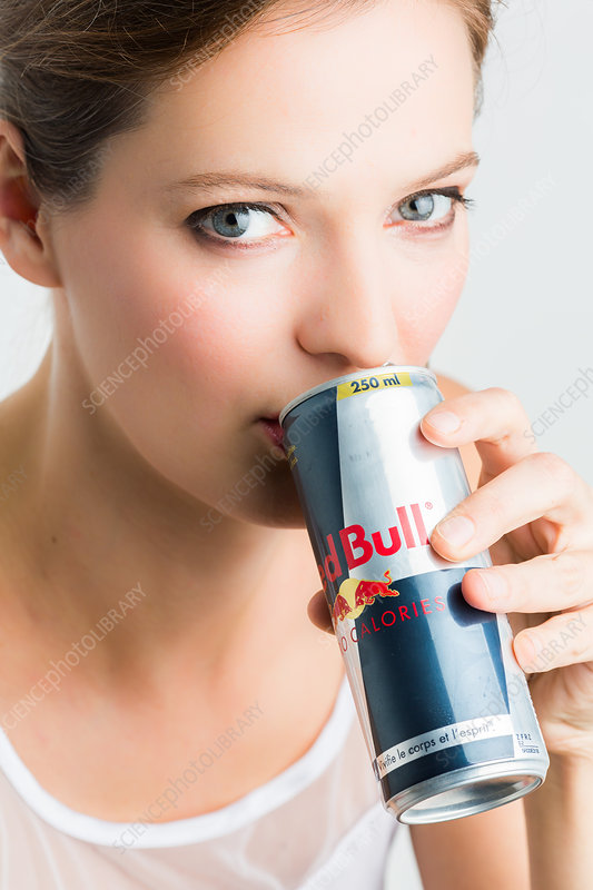Woman drinking Red Bull