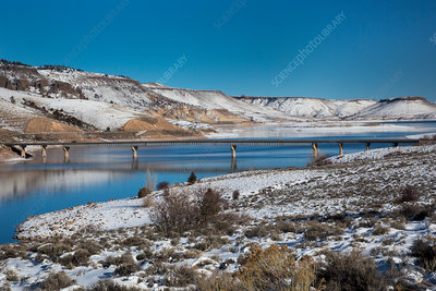 Road bridge over a reservoir in winter, USA