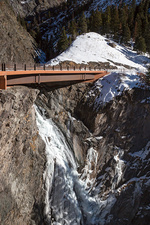 Road bridge over a mountain gorge in winter, USA