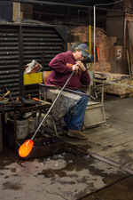 Glassblower using a blowpipe