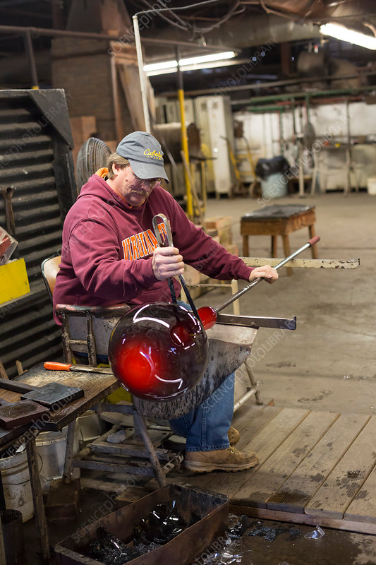 Glassblower shaping a glass vessel