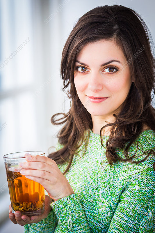 Woman drinking linden sapwood herbal tea