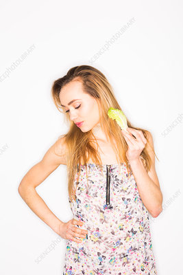 Woman eating lettuce