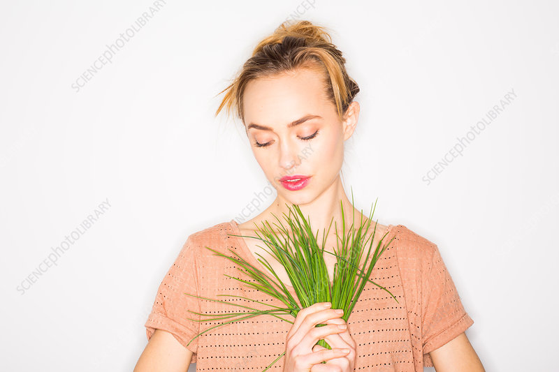Woman holding chives
