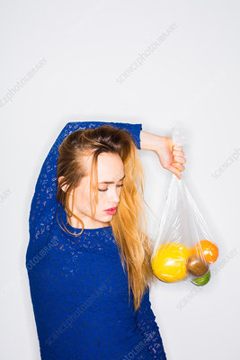 Woman holding fruits
