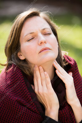 Woman with sorethroat