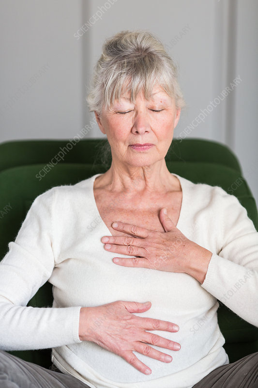 Senior woman practicing respiratory exercises
