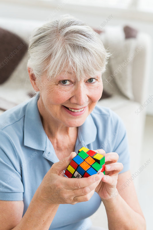 Senior woman playing with a Rubik's cube