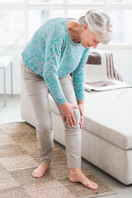 Senior woman suffering from a pain in the knee