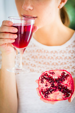 Woman drinking pomegranate juice