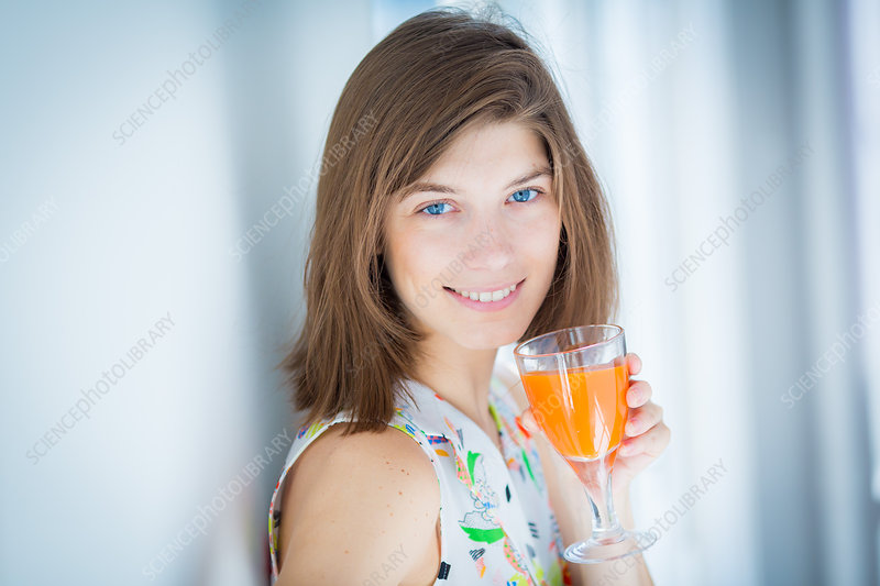 Woman drinking fruit juice