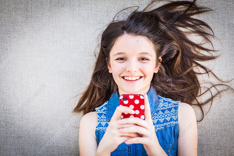 Teenage girl using a Smartphone
