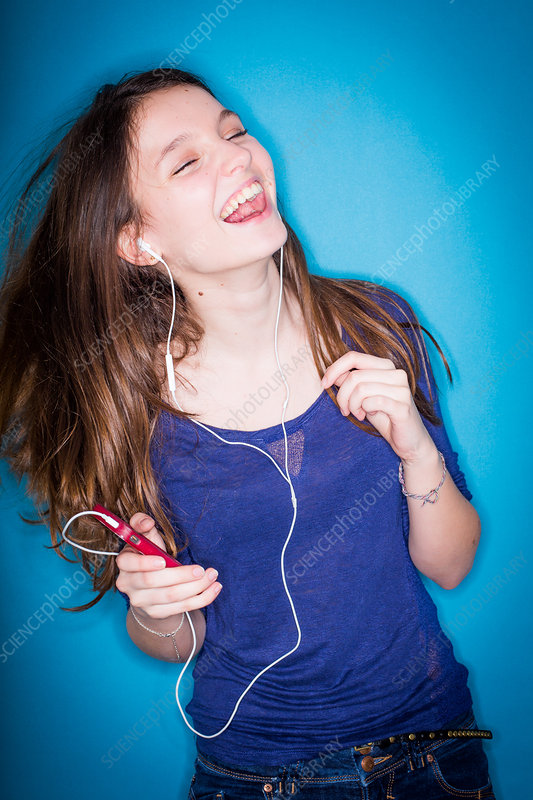 Adolescent listening to music