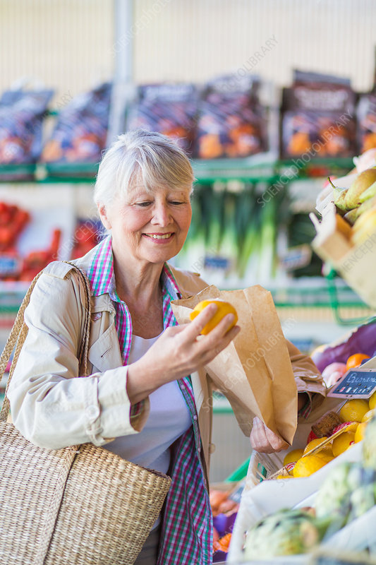 Senior woman buying fruits and vegetables