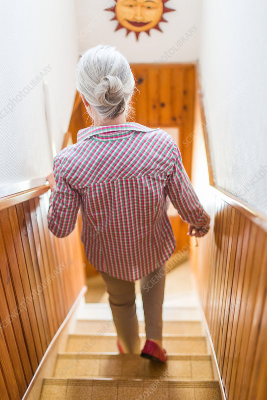 Senior woman on the stairs