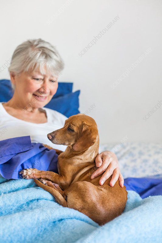 Senior woman resting with her dog