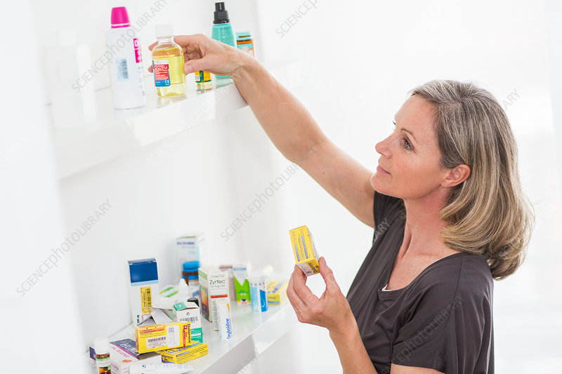 Woman sorting old medicines