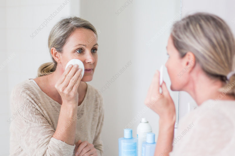 Woman using a make-up remover
