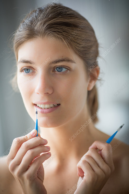 Woman using an interdental brush