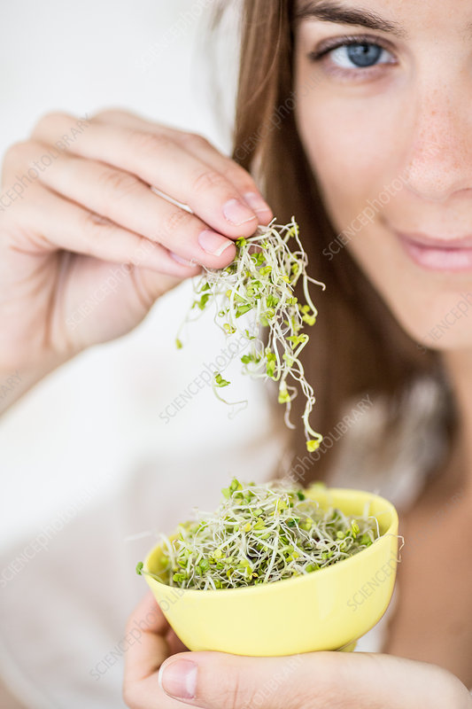 Woman eating sprouts
