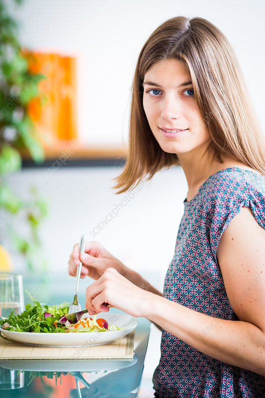 Woman eating a salad