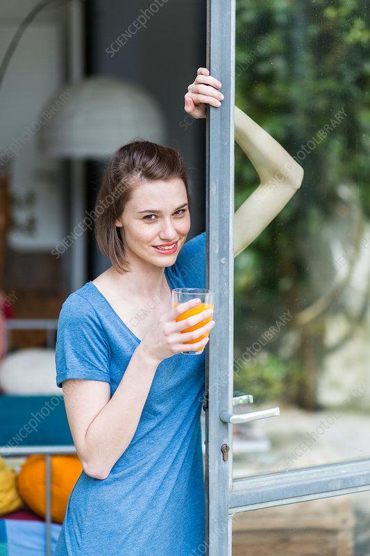 Woman drinking fruit juice