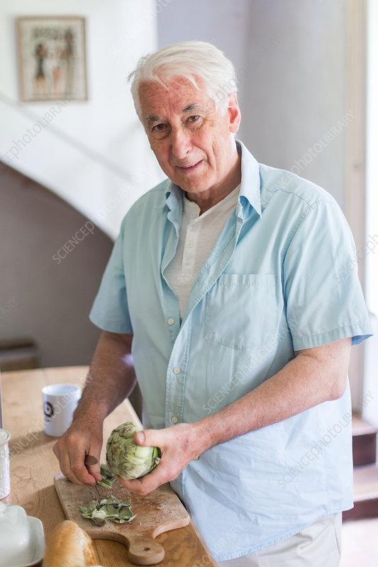 Man preparing artichokes