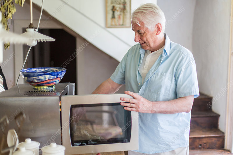 Man using a microwave oven