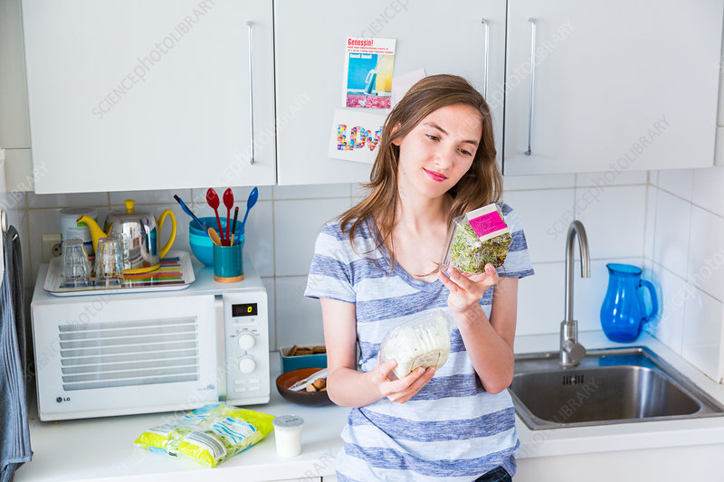Woman checking nutritional facts