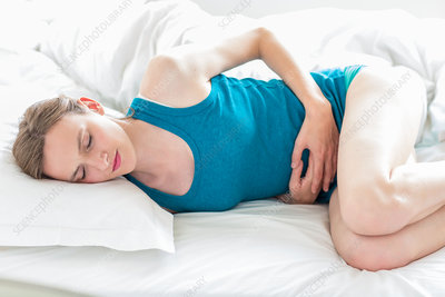 Woman suffering from abdominal pain