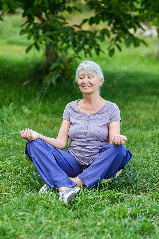 Senior woman in the lotus position