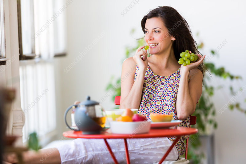 Woman having breakfast