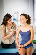 Teenage girl receiving Gardasil vaccination