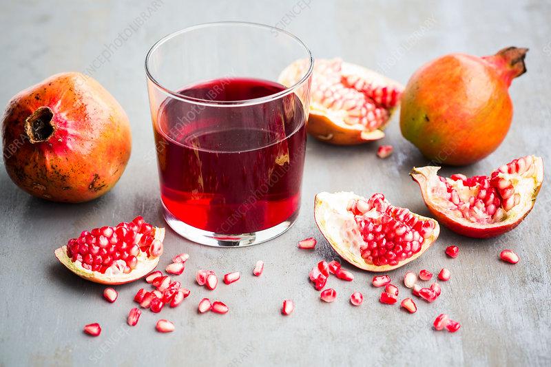 Halved pomegranate juice