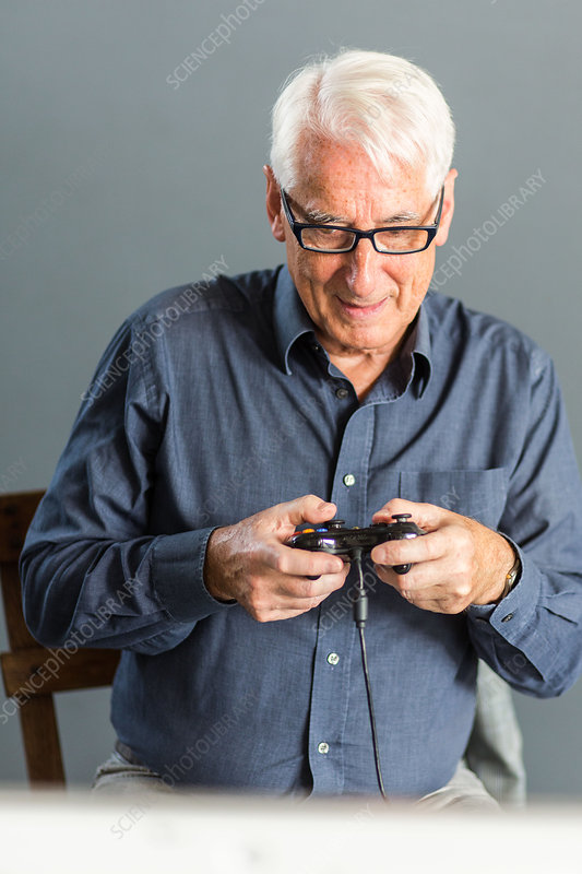 Senior man playing videogames
