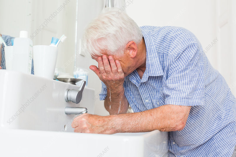 Man splashing water over his face